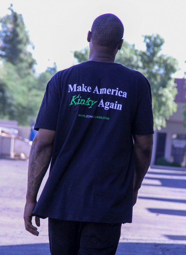 "Zong T Shirt Facing Away Walking ""Make America Kinky Again"" - Black with Green and white lettering"
